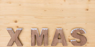 X MAS. The word X MAS made on wood on wood Stock Images