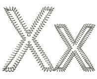 The X of a metal spring Stock Photography
