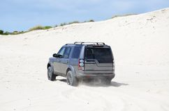 4x4 0n sand. 4X4 suv on white sand outdoors driving Stock Photos