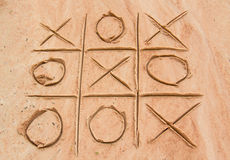 X and O game on the sand. Beach game title two wins Royalty Free Stock Photos