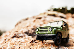 4x4 offroad car. Miniature 4x4 offroad car on the edge of a cliff Royalty Free Stock Photography