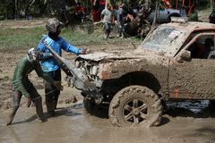 4x4Offroad car - 4wd vehicle is driving uphill out of water and Royalty Free Stock Photography