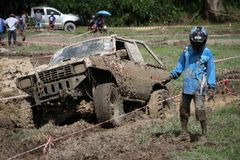 4x4Offroad car - 4wd vehicle is driving uphill out of water and Royalty Free Stock Images
