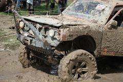 4x4Offroad car - 4wd vehicle is driving uphill out of water and Stock Images