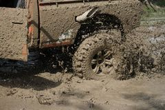 4x4Offroad car - 4wd vehicle is driving uphill out of water and Stock Photo