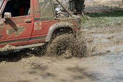 4x4Offroad car - 4wd vehicle is driving uphill out of water and Royalty Free Stock Photos
