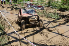 4x4 offroad vehicle in mud. 4x4 offroad vehicle driving in mud Stock Photography