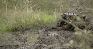 A 4x4 offroad vehicle splunging on the mud  FS700 4K stock video