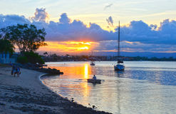 3000x1943pix-sunset-in-the-bay-boat-beach Stock Images