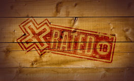 X Rated stamp. On wooden background Royalty Free Stock Photo