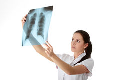 X-ray. Female doctor looking at an x-ray Stock Image