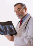 X-ray. Doctor looking at an xray stock photography
