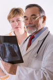 X-ray. Two doctors looking at an xray royalty free stock images