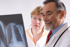 X-ray. Two doctors looking at an xray stock photos