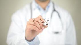 X-Ray, Doctor writing on transparent screen royalty free stock images