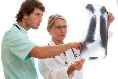 X-ray examination. Male and female doctor consulting x-ray examination stock images