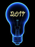 X-Ray lightbulb with sparkling 2017 digits inside isolated on black Stock Images
