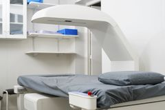 X-Ray Machine Over Bed At Hospital. White x-ray machine over bed at hospital Stock Image