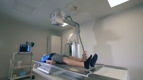 X-ray mechanism is imaging a lying man