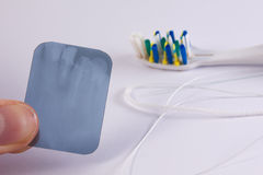 X-ray picture with a toothbrush and a dental floss. On white background Stock Image
