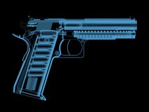 X-ray of a pistol with bullets. Stock Photo