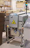X-ray quality control device. On food processing plant Royalty Free Stock Photo