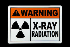 X-Ray Radiation. A x-ray radiation warning sign against a black background royalty free stock photos