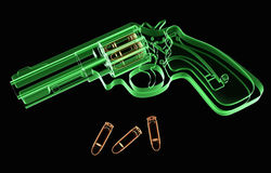 X-ray revolver. X-ray image of a revolver and ammunition on black background royalty free illustration