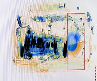 X-ray screenshot of an backpack filled with tele zoom camera and camcorder.  Royalty Free Stock Image