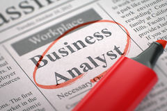 We're Hiring Business Analyst. 3D. A Newspaper Column in the Classifieds with the Vacancy of Business Analyst, Circled with a Red Highlighter. Blurred Image stock photo