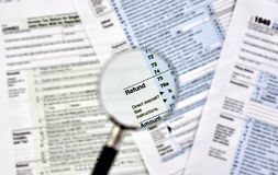 & x27;Refund& x27; under magnifying glass Royalty Free Stock Photo