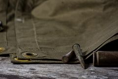 7,92 x 57 - rustic ammos, poncho and old compas lies on the wooden background. Close up stock photography