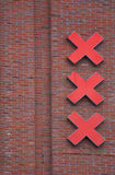 X's on brick wall. Three large red X's attached to the side of a red brick building Stock Photos