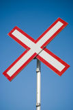 X-shaped sign. Red X-shaped sign on blue sky background Stock Images