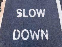 'SLOW DOWN' sign marking on bike lane Stock Images