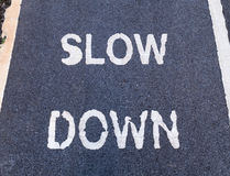 'SLOW DOWN' sign marking on bike lane Stock Images