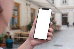 X smartphone in vrouwenhand Het geïsoleerde scherm voor gebruikersinterfacemodel Royalty-vrije Stock Fotografie