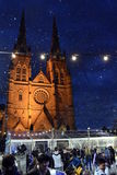 Snowing at St. Mary's Cathedral on the ice rink. Royalty Free Stock Photos