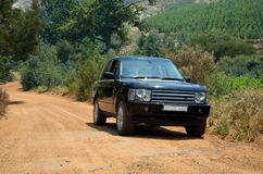 SUV on a dirt road. 4x4 SUV on a dirt road route Stock Photo