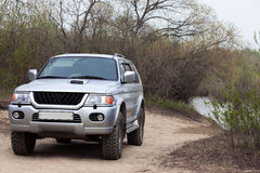 4x4 SUV on a road near a pond Stock Image
