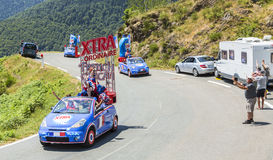 X-tra Total Caravan in Pyrenees Mountains - Tour de France 2015. Col D'Aspin,France- July 15,2015: X-tra Total Caravan during the passing of the Publicity Royalty Free Stock Photos