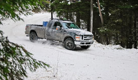 4x4 truck drifting on winter snow road in forest Stock Photos