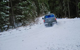 4x4 truck drifting on winter snow road in forest. 4-wheel drive truck in a forest on a snowy road Stock Photos
