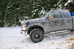 4x4 truck drifting on winter snow road in forest. 4-wheel drive truck in a forest on a snowy road Stock Photo