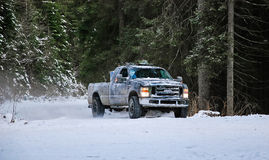4x4 truck drifting on winter snow road in forest. 4-wheel drive truck in a forest on a snowy road Stock Images