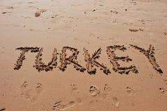 & x22; Turkey& x22;写在沙子在海滩 免版税库存图片