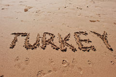 'Turkey' written in the sand on the beach. royalty free stock images