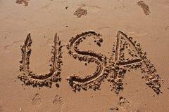 & x22; USA& x22;写在沙子在海滩 库存照片