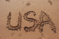 """USA"" written in the sand on the beach. Stock Photo"