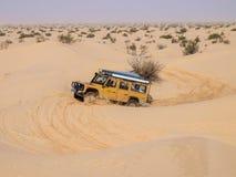 4X4 vehicle drives around the sand dunes of the Sahara Desert. Stock Photo